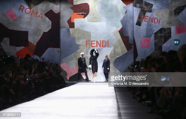 Fashion designer Karl Lagerfeld model Cara Delevingne and Silvia Venturini Fendi acknowledge the applause of the audience after the Fendi show as...
