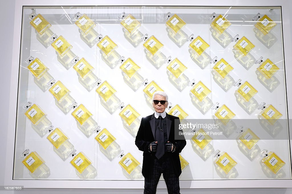 Fashion designer Karl Lagerfeld poses in front of his works before the Chanel show as part of the Paris Fashion Week Womenswear Spring/Summer 2014, held at Grand Palais on October 1, 2013 in Paris, France.