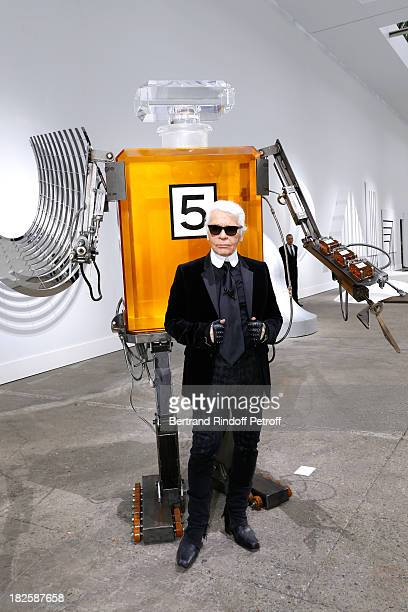 Fashion designer Karl Lagerfeld poses in front of his works before the Chanel show as part of the Paris Fashion Week Womenswear Spring/Summer 2014...