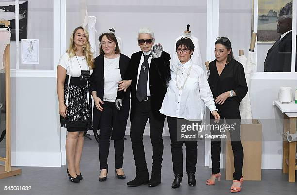 Fashion designer Karl Lagerfeld poses with Chanel's seamstresses during during the Chanel Haute Couture Fall/Winter 20162017 show as part of Paris...