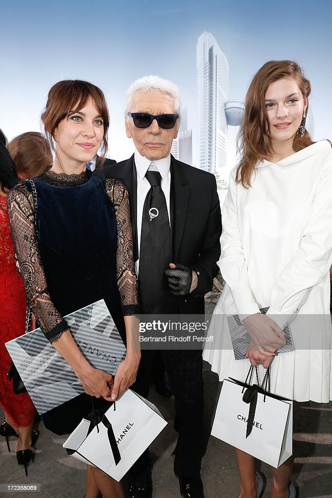 Fashion designer Karl Lagerfeld stands between Alexa Chung and Amber Anderson attend the Chanel show as part of Paris Fashion Week Haute-Couture Fall/Winter 2013-2014 at Grand Palais on July 2, 2013 in Paris, France.
