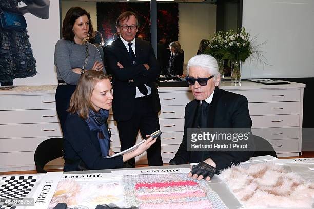 Fashion designer Karl Lagerfeld with journalist at the showroom of 'Maison Lemarie' as he visits 'Les Ateliers d'Art' belonging to 'La Maison Chanel'...