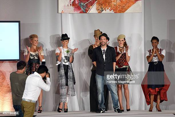 Fashion designer Kay Rainer and models pose during the Sixt ladies dirndl dinner on July 15 2014 in Munich Germany