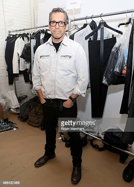 Fashion designer Kenneth Cole poses backstage at the Kenneth Cole Collection presentation during MercedesBenz Fashion Week Fall 2014 at The Garage at...
