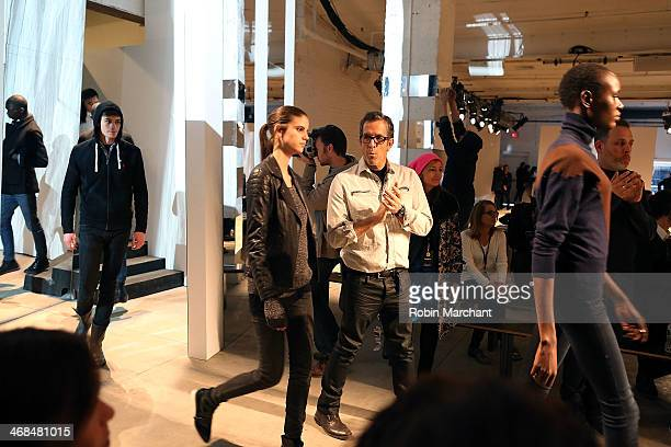 Fashion designer Kenneth Cole prepares backstage at the Kenneth Cole Collection presentation during MercedesBenz Fashion Week Fall 2014 at The Garage...