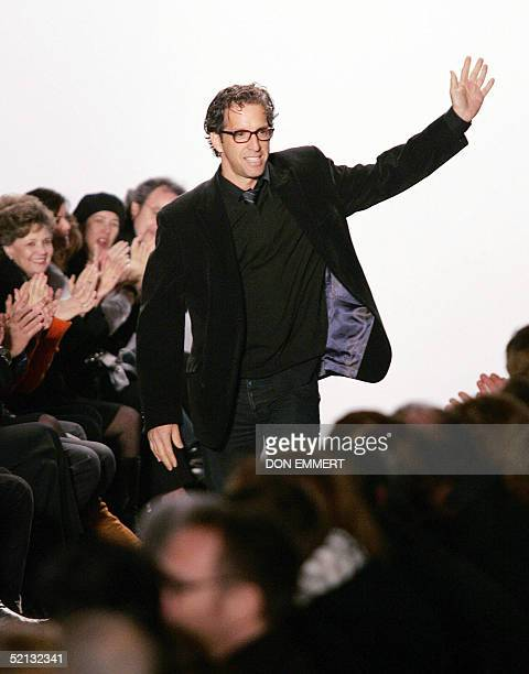 US fashion designer Kenneth Cole waves to the audience after his Fall 2005 fashion show 04 February 2005 in New York AFP PHOTO/Don EMMERT