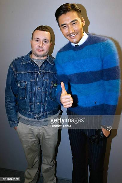 Fashion designer Kim Jones and Model and actor Hu Bing pose backstage after the Louis Vuitton Menswear Fall/Winter 20152016 Show as part of Paris...