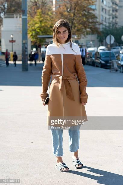 Fashion Designer Kimberley Jenneskens wears her own design jacket Sandro top Maison Margiela jeans and Adidas slides on day 3 during Paris Fashion...