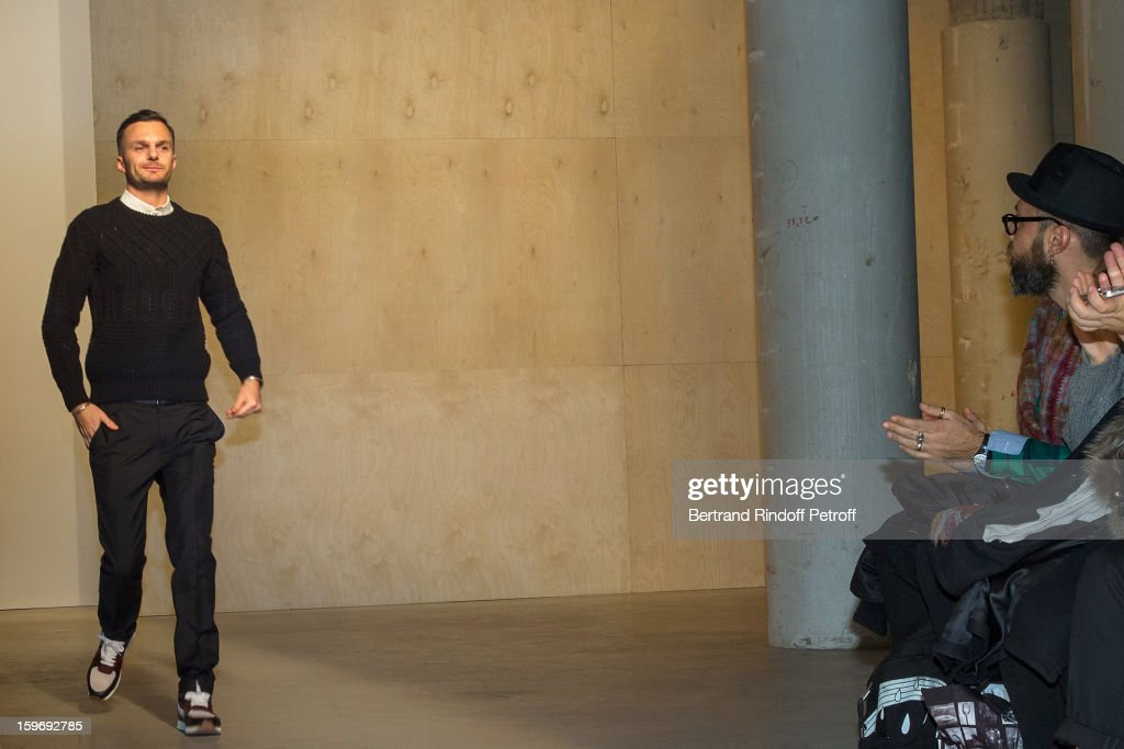 Fashion designer Kris Van Assche (L) acknowledges applause at the end of the Krisvanassche Men Autumn / Winter 2013 show as part of Paris Fashion Week on January 18, 2013 in Paris, France.