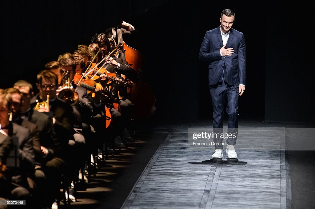Fashion designer <a gi-track='captionPersonalityLinkClicked' href=/galleries/search?phrase=Kris+Van+Assche+-+Fashion+Designer&family=editorial&specificpeople=5744788 ng-click='$event.stopPropagation()'>Kris Van Assche</a> acknowledges the applause of the audience after the Dior Homme Menswear Fall/Winter 2015-2016 show as part of Paris Fashion Week on January 24, 2015 in Paris, France.