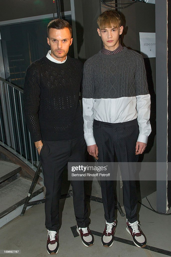 Fashion designer Kris Van Assche (L) and a model attend the Krisvanassche Men Autumn / Winter 2013 show as part of Paris Fashion Week on January 18, 2013 in Paris, France.
