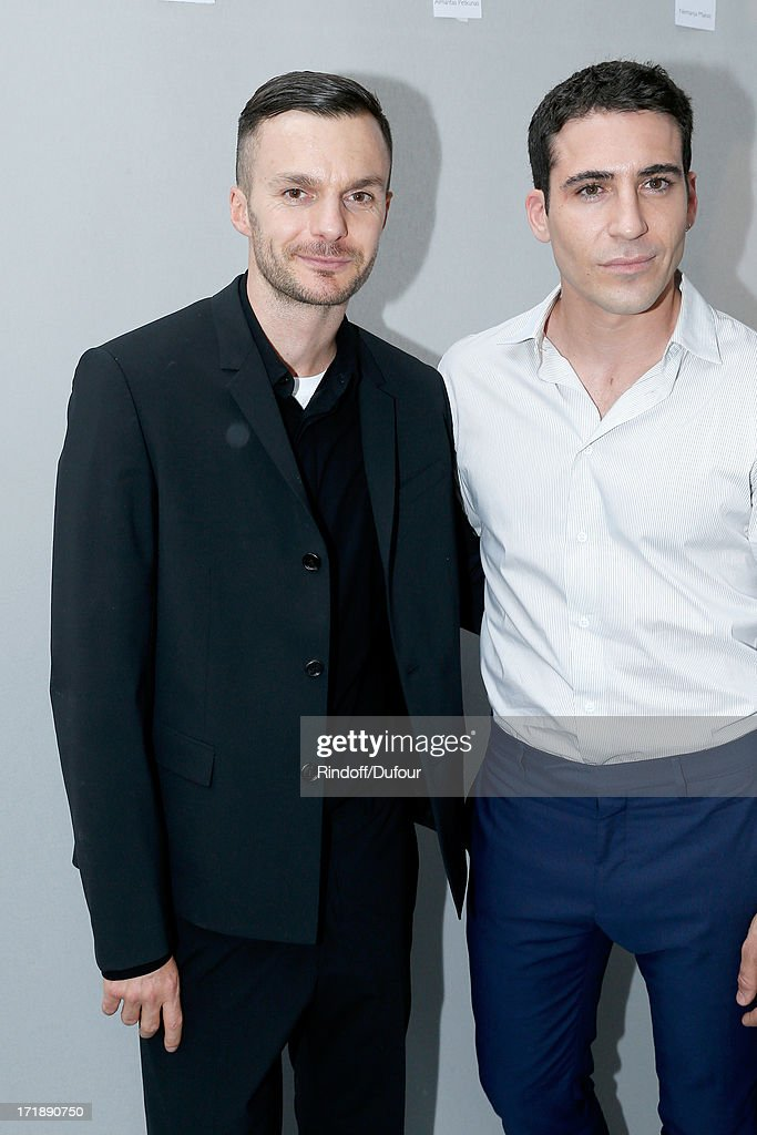 Fashion designer Kris Van Assche and actor <a gi-track='captionPersonalityLinkClicked' href=/galleries/search?phrase=Miguel+Angel+Silvestre&family=editorial&specificpeople=4001600 ng-click='$event.stopPropagation()'>Miguel Angel Silvestre</a> backstage after Dior Homme Menswear Spring/Summer 2014 Show as part of the Paris Fashion Week on June 29, 2013 in Paris, France.
