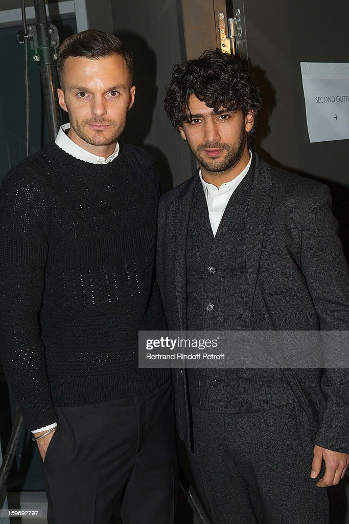 Fashion designer Kris Van Assche (L) and actor Salim Kechiouche attend the Krisvanassche Men Autumn / Winter 2013 show as part of Paris Fashion Week on January 18, 2013 in Paris, France.
