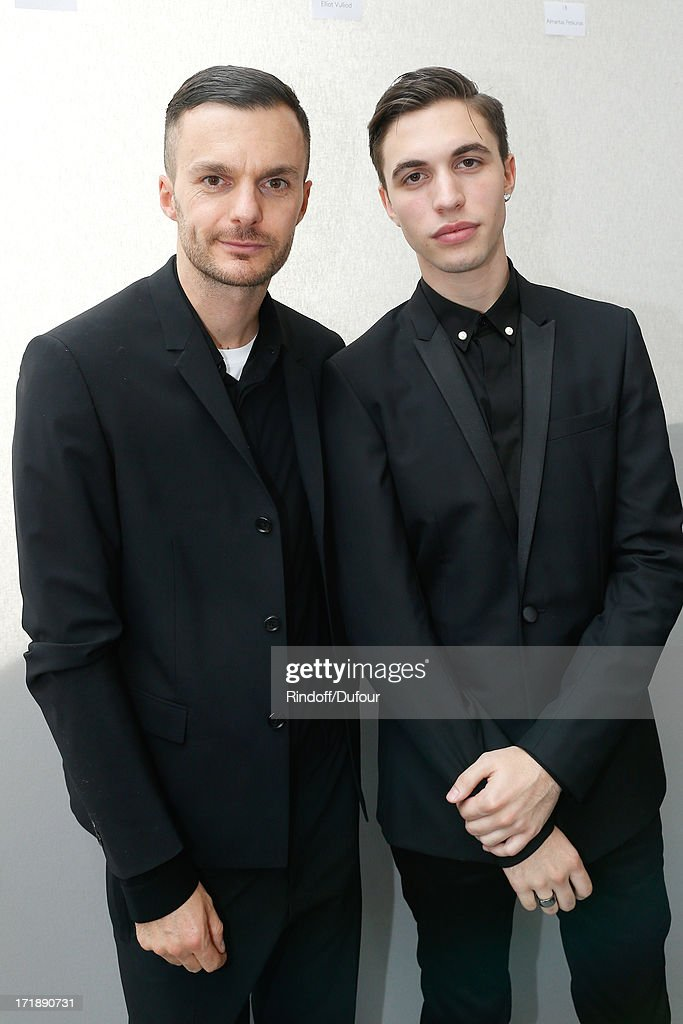 Fashion designer Kris Van Assche and Alex Fleming aka Black Atlass backstage after Dior Homme Menswear Spring/Summer 2014 Show as part of the Paris Fashion Week on June 29, 2013 in Paris, France.