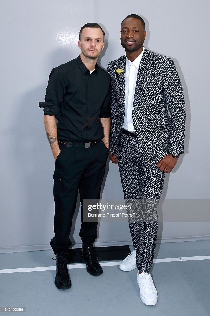 Fashion designer Kris Van Assche and Basket-ball player <a gi-track='captionPersonalityLinkClicked' href=/galleries/search?phrase=Dwyane+Wade&family=editorial&specificpeople=201481 ng-click='$event.stopPropagation()'>Dwyane Wade</a> pose Backstage after the Dior Homme Menswear Spring/Summer 2017 show as part of Paris Fashion Week on June 25, 2016 in Paris, France.