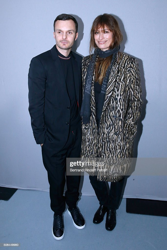 Fashion designer <a gi-track='captionPersonalityLinkClicked' href=/galleries/search?phrase=Kris+Van+Assche+-+Fashion+Designer&family=editorial&specificpeople=5744788 ng-click='$event.stopPropagation()'>Kris Van Assche</a> and <a gi-track='captionPersonalityLinkClicked' href=/galleries/search?phrase=Caroline+de+Maigret&family=editorial&specificpeople=7082665 ng-click='$event.stopPropagation()'>Caroline de Maigret</a> pose Backstage after the Dior Homme Menswear Fall/Winter 2016-2017 show as part of Paris Fashion Week on January 23, 2016 in Paris, France.