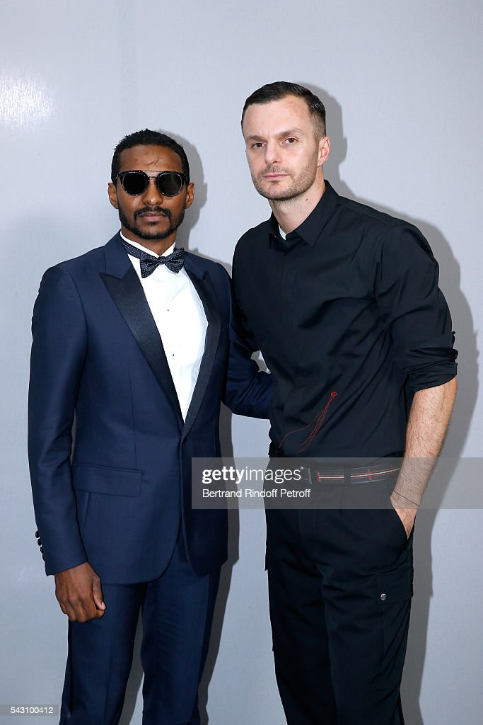 Fashion designer Kris Van Assche (R) and guest pose Backstage after the Dior Homme Menswear Spring/Summer 2017 show as part of Paris Fashion Week on June 25, 2016 in Paris, France.