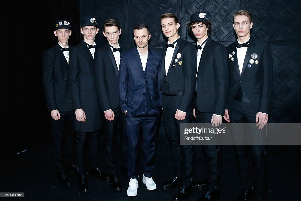 Fashion designer <a gi-track='captionPersonalityLinkClicked' href=/galleries/search?phrase=Kris+Van+Assche+-+Fashion+Designer&family=editorial&specificpeople=5744788 ng-click='$event.stopPropagation()'>Kris Van Assche</a> and his models pose backstage after the Dior Homme Menswear Fall/Winter 2015-2016 Show as part of Paris Fashion Week on January 24, 2015 in Paris, France.