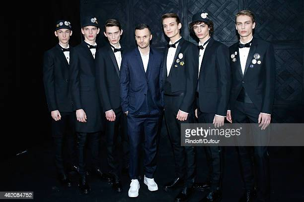 Fashion designer Kris Van Assche and his models pose backstage after the Dior Homme Menswear Fall/Winter 20152016 Show as part of Paris Fashion Week...