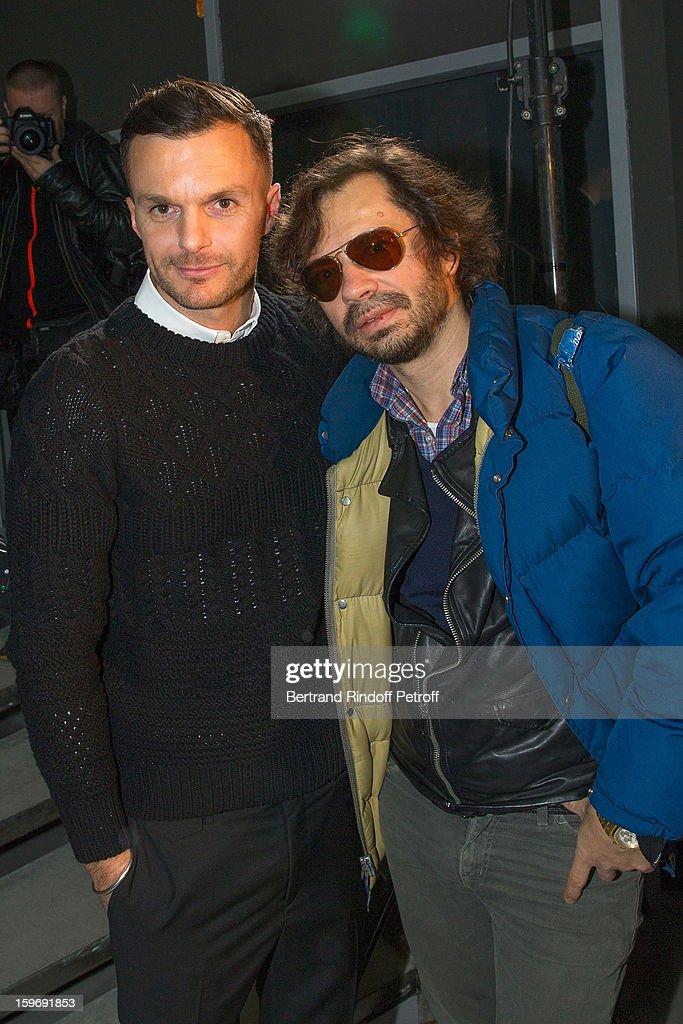 Fashion designer Kris Van Assche (L) and Olivier Zahn attend the Krisvanassche Men Autumn / Winter 2013 show as part of Paris Fashion Week on January 18, 2013 in Paris, France.
