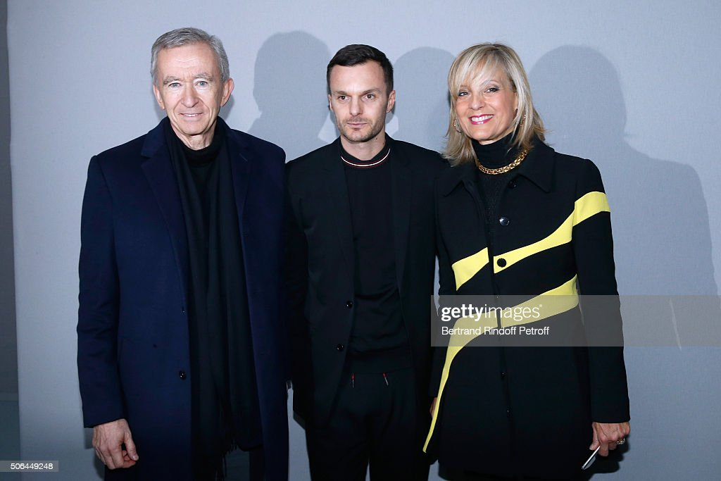 Fashion designer <a gi-track='captionPersonalityLinkClicked' href=/galleries/search?phrase=Kris+Van+Assche+-+Fashion+Designer&family=editorial&specificpeople=5744788 ng-click='$event.stopPropagation()'>Kris Van Assche</a> pose Backstage between Owner of LVMH Luxury Group <a gi-track='captionPersonalityLinkClicked' href=/galleries/search?phrase=Bernard+Arnault&family=editorial&specificpeople=214118 ng-click='$event.stopPropagation()'>Bernard Arnault</a> and his wife <a gi-track='captionPersonalityLinkClicked' href=/galleries/search?phrase=Helene+Arnault&family=editorial&specificpeople=718530 ng-click='$event.stopPropagation()'>Helene Arnault</a> after the Dior Homme Menswear Fall/Winter 2016-2017 show as part of Paris Fashion Week on January 23, 2016 in Paris, France.