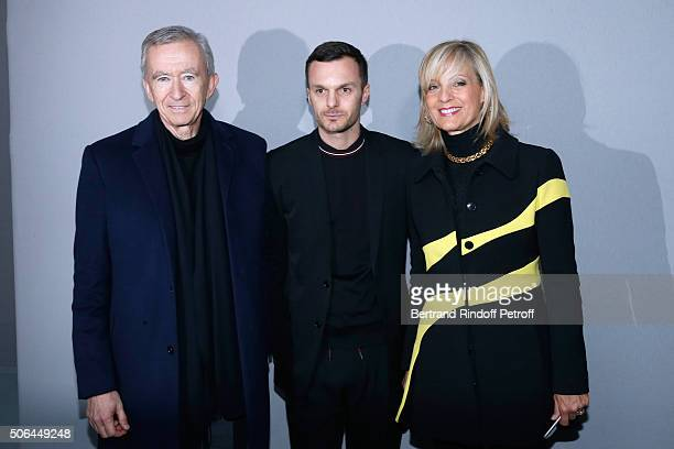 Fashion designer Kris Van Assche pose Backstage between Owner of LVMH Luxury Group Bernard Arnault and his wife Helene Arnault after the Dior Homme...