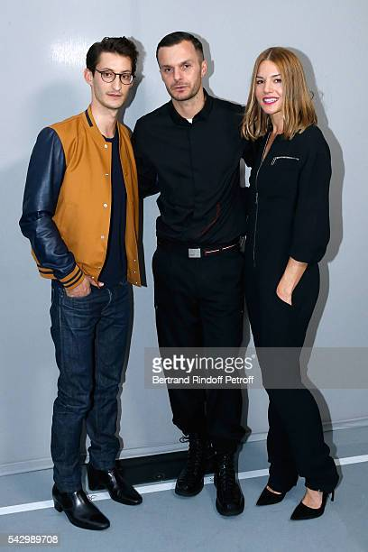 Fashion designer Kris Van Assche pose Backstage between Pierre Niney and Natasha Andrews after the Dior Homme Menswear Spring/Summer 2017 show as...