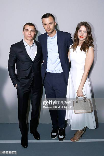 Fashion designer Kris Van Assche standing between Actors Dave Franco and Alisson Brie pose Backstage after the Dior Homme Menswear Spring/Summer 2016...