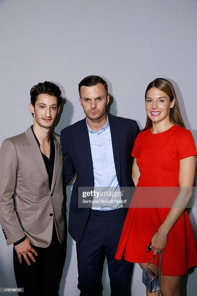 Fashion designer <a gi-track='captionPersonalityLinkClicked' href=/galleries/search?phrase=Kris+Van+Assche+-+Fashion+Designer&family=editorial&specificpeople=5744788 ng-click='$event.stopPropagation()'>Kris Van Assche</a> standing between Actors <a gi-track='captionPersonalityLinkClicked' href=/galleries/search?phrase=Natasha+Andrews&family=editorial&specificpeople=9166204 ng-click='$event.stopPropagation()'>Natasha Andrews</a> (R) and <a gi-track='captionPersonalityLinkClicked' href=/galleries/search?phrase=Pierre+Niney&family=editorial&specificpeople=8306328 ng-click='$event.stopPropagation()'>Pierre Niney</a> (L) pose Backstage after the Dior Homme Menswear Spring/Summer 2016 show as part of Paris Fashion Week on June 27, 2015 in Paris, France.