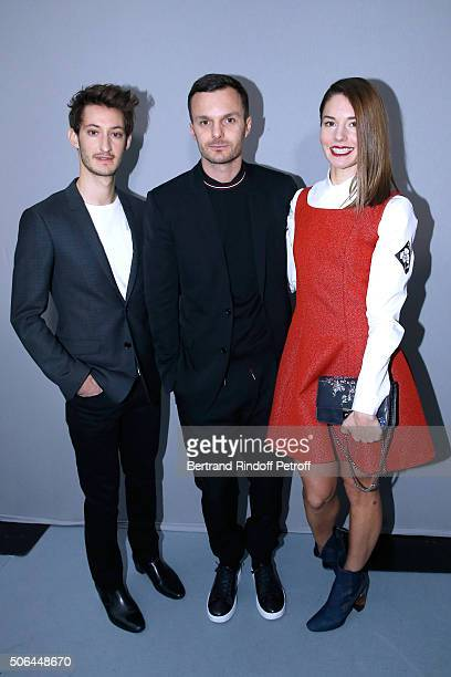 Fashion designer Kris Van Assche standing between Actors Pierre Niney and Natasha Andrews pose Backstage after the Dior Homme Menswear Fall/Winter...
