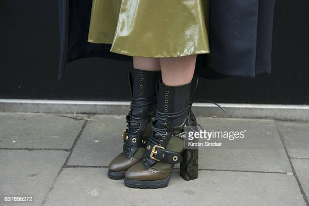 Fashion Designer Lana Puljic wears Burberry boots and a Soel skirt day 1 of London Mens Fashion Week Autumn/Winterr 2017 on January 06 2017 in London...