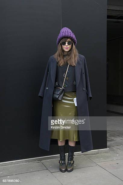 Fashion Designer Lana Puljic wears Burberry boots Soel skirt sweater and hat Chanel bag Top shop jacket and Kubboraum sunglasses day 1 of London Mens...