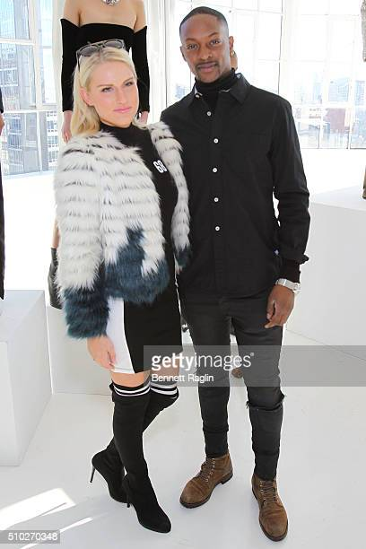 Fashion designer LaQuan Smith and guest pose during SheaMoisture at Laquan Smith F/W 2016 NYFW at Jack Studios on February 14 2016 in New York City