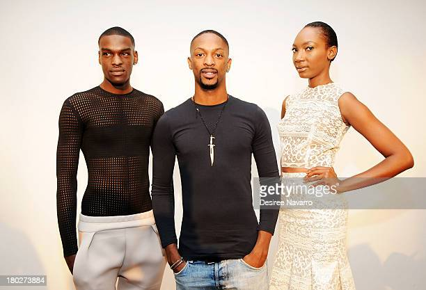 Fashion designer Laquan Smith poses with models at the Laquan Smith presentation during MercedesBenz Fashion Week on September 10 2013 in New York...
