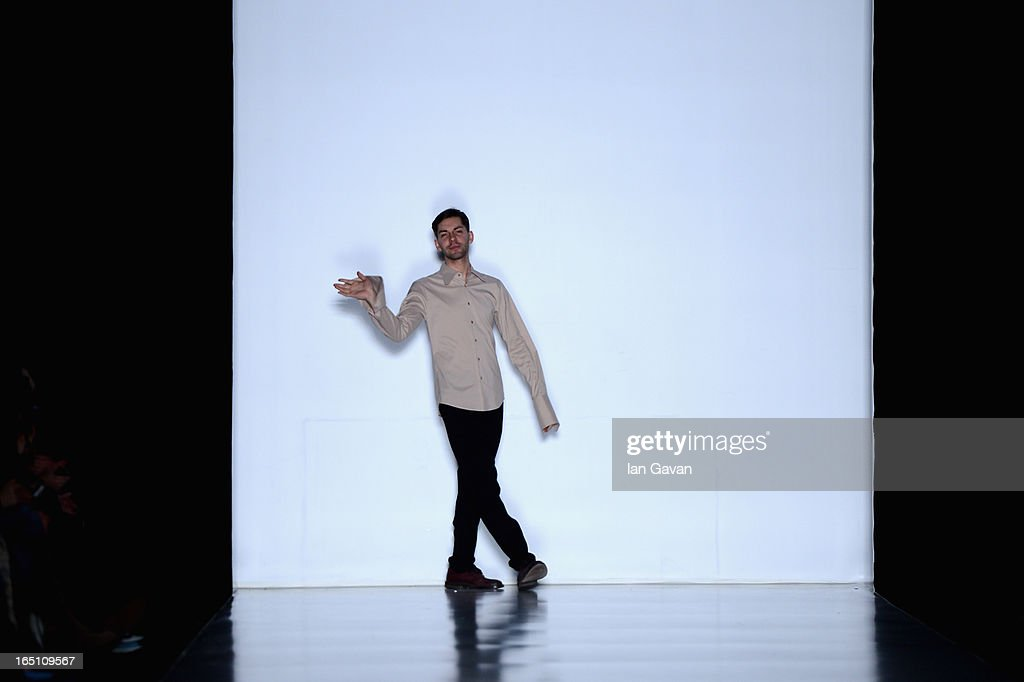Fashion designer Leonid Alexeev acknowledges applause following the Leonid Alexeev show during Mercedes-Benz Fashion Week Russia Fall/Winter 2013/2014 at Manege on March 30, 2013 in Moscow, Russia.