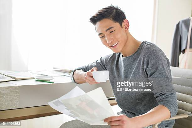 Fashion designer looking at sketch