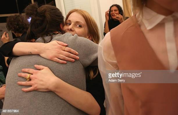 Fashion designer Malaika Raiss hugs an assistant after the Malaikaraiss show during the MercedesBenz Fashion Week Berlin Autumn/Winter 2015/16 at FAZ...