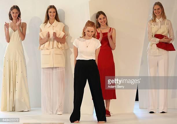 Fashion Designer Malaika Raiss takes a bow in front of models at the Malaikaraiss show during the MercedesBenz Fashion Week Berlin Spring/Summer 2017...