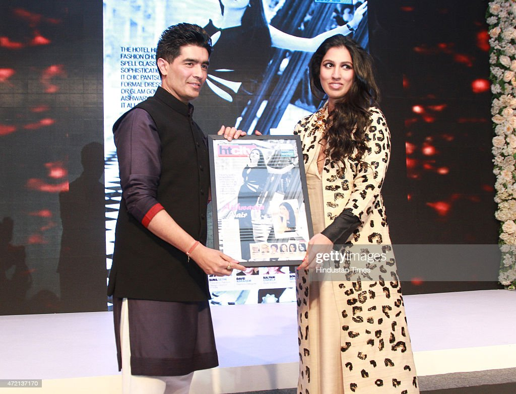 Fashion designer <a gi-track='captionPersonalityLinkClicked' href=/galleries/search?phrase=Manish+Malhotra+-+Fashion+Designer&family=editorial&specificpeople=4458343 ng-click='$event.stopPropagation()'>Manish Malhotra</a> presenting the most stylish award to Aishwarya Nair, director, Leela Group of Hotels at the Hindustan Times Delhis Most Stylish 2015 award function on May 2, 2015 in New Delhi, India
