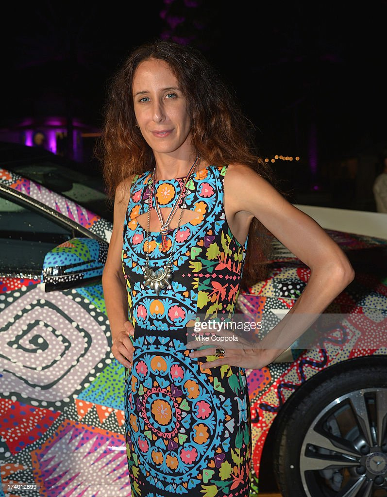Fashion designer Mara Hoffman poses in front of the 2014 Mercedes-Benz E350 Cabriolet by Mara Hoffman at Mercedes-Benz Fashion Week Swim 2014 Official Coverage - Day 1 at Raleigh Hotel on July 18, 2013 in Miami Beach, Florida.