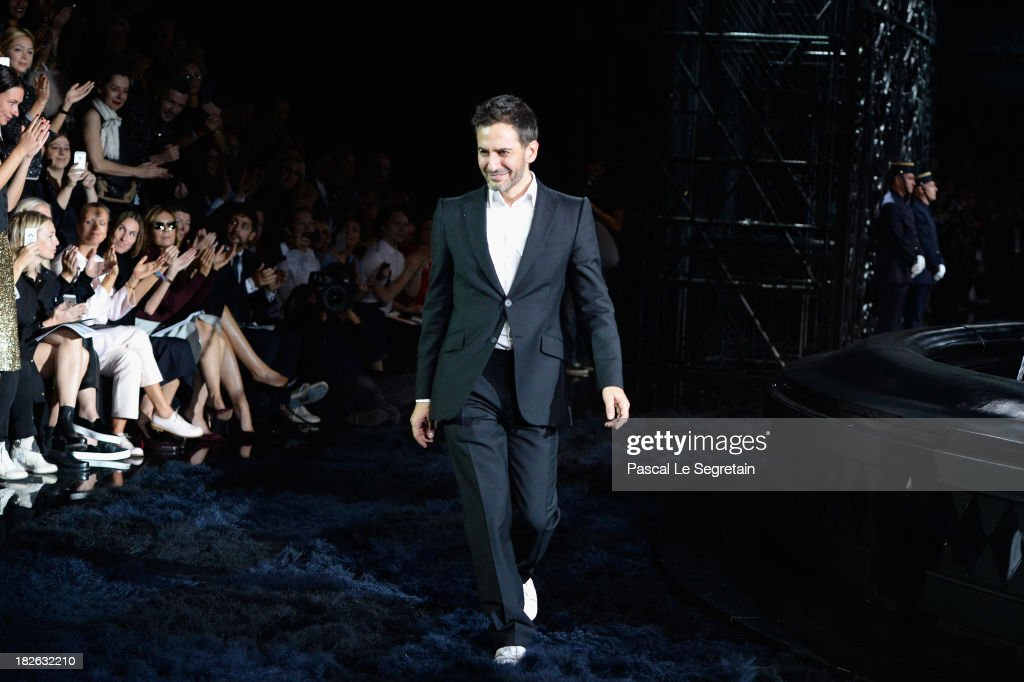 Fashion designer Marc Jacobs acknowledges applause following the Louis Vuitton show as part of the Paris Fashion Week Womenswear Spring/Summer 2014 at Le Carre du Louvre on October 2, 2013 in Paris, France.