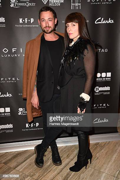 Fashion designer Marcel Ostertag and a German singer attend the 'Marcel Ostertag Charity Fashion Show 2015' at Sofitel Munich Bayerpost on November...