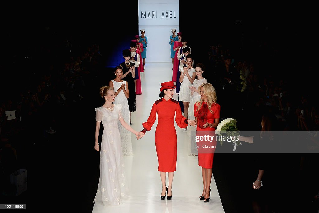 Fashion designer Mari Axel acknowledges applause following the Mari Axel show during Mercedes-Benz Fashion Week Russia Fall/Winter 2013/2014 at Manege on March 31, 2013 in Moscow, Russia.