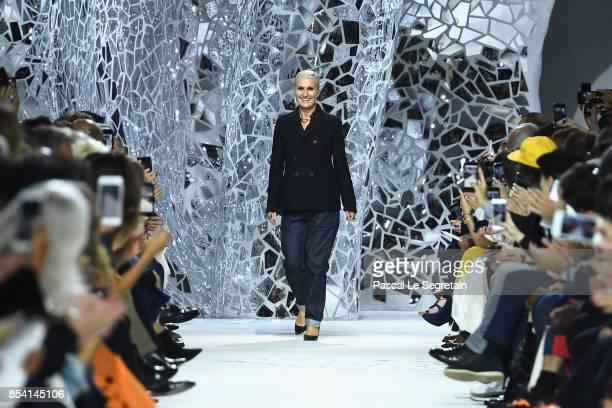 Fashion designer Maria Grazia Chiuri walks the runway after the Christian Dior show as part of the Paris Fashion Week Womenswear Spring/Summer 2018...
