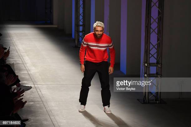 Fashion designer Massimo Giorgetti acknowledges the applause of the audience at the MSGM show during Milan Men's Fashion Week Spring/Summer 2018 on...