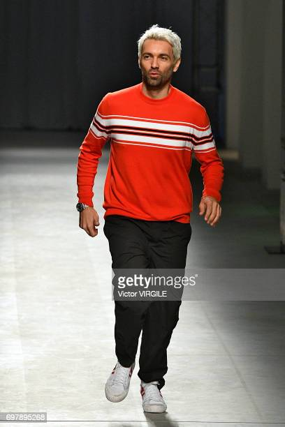 Fashion designer Massimo Giorgetti walks the runway at the MSGM show during Milan Men's Fashion Week Spring/Summer 2018 on June 18 2017 in Milan Italy