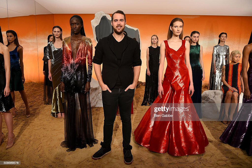 Fashion designer Mathieu Mirano poses with models at the Mathieu Mirano presentation during Fall 2016 New York Fashion Week at Pier 59 Studios on February 11, 2016 in New York City.
