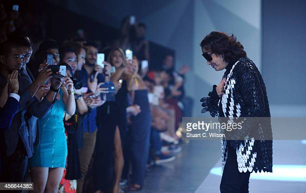 Fashion designer Michael Cinco on the runway after his show during Fashion Forward at Madinat Jumeirah on October 4 2014 in Dubai United Arab Emirates