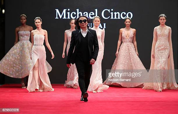Fashion designer Michael Cinco with models walk the red carpet after his show during D3 Presents DIFF Fashion Forward on day seven of the 13th annual...