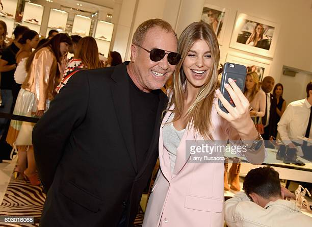 Fashion designer Michael Kors and model Cami Morrone attend the Michael Kors Access Smartwatch launch party at Michael Kors on September 11 2016 in...